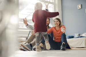 Happy family playing with their son at home - KNSF03743