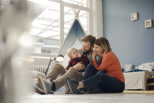 Happy family playing with their son at home - KNSF03746