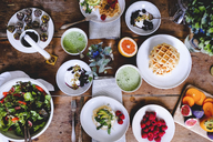 Directly above shot of various food on wooden table - MASF00826