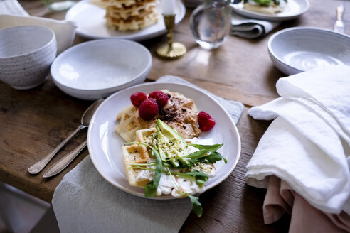 Close-up of food on plate at wooden table - MASF00838