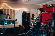 Performers playing instruments while practicing in studio - MASF00862