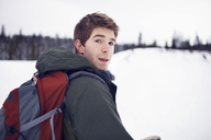 Portrait of backpacker in field - CAVF35271