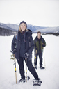 Portrait of woman with her adult son snowshoeing - CAVF35274