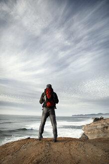 Man standing on edge of cliff - CAVF35352