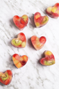 Homemade heart-shaped ice cubes on marble - RTBF01152