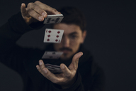 Magician conjuring with playing cards, close-up - KNSF03790