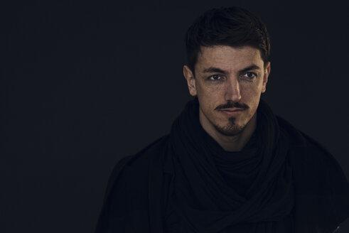 Portrait of bearded man in front of dark background - KNSF03796