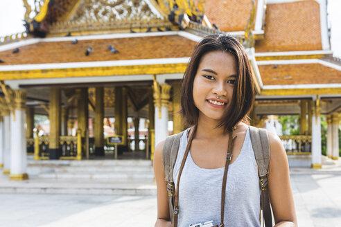 Thailand, Bangkok, portrait of smiling tourist with camera - WPEF00180