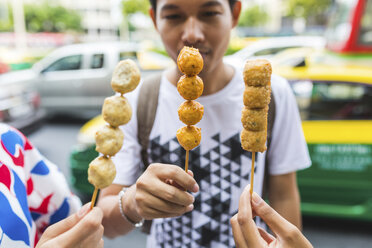 Thailand, Bangkok, group of friends eating street food, close-up - WPEF00183