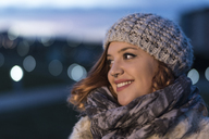 Portrait of relaxed young woman at evening twilight in winter - JASF01886