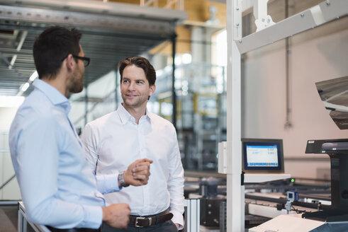 Two businessmen talking in modern factory - DIGF03699