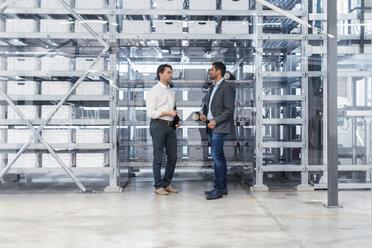 Two businessmen talking in modern factory - DIGF03711