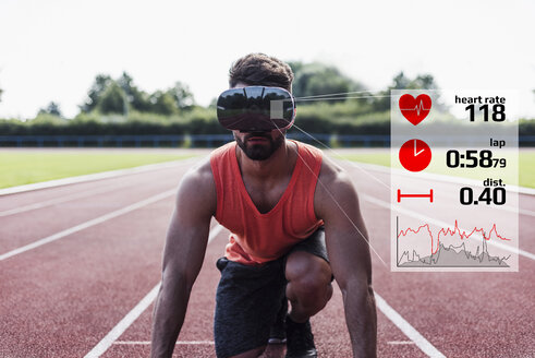 Athlete in starting position on tartan track with data emerging from VR glasses - UUF13257