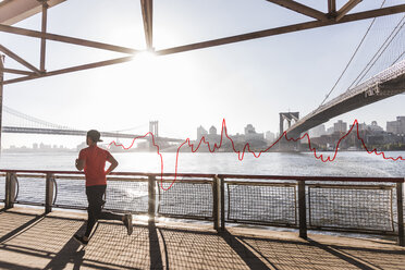 USA, New York City, man running at East River with line graph behind him - UUF13260