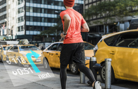USA, New York City, man running in the city with data around him - UUF13263