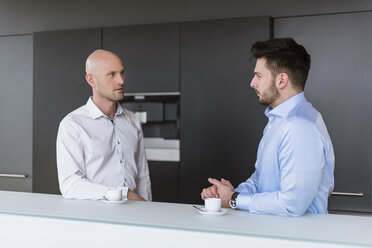 Two businessmen having a discussion in break room - DIGF03802