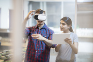 Colleagues using a VR headset - ZEF15278