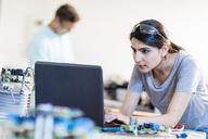 Woman in workshop using laptop - ZEF15287