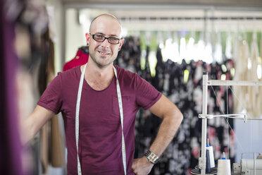 Portrait of smiling tailor in studio - ZEF15329