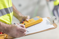 Close-up of electrician taking notes - ZEF15341