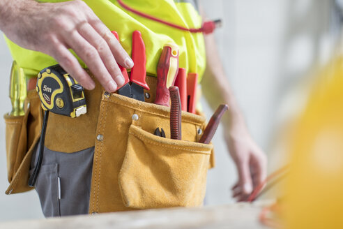 Close-up of construction worker with tool belt - ZEF15344