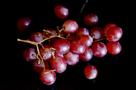 Red grapes on black ground - JTF00969
