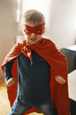 Portrait of little boy dressed up as a superhero at home - ZEDF01311