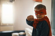Portrait of little boy dressed up as a superhero at home - ZEDF01317