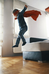Little boy dressed up as a superhero playing at home - ZEDF01320
