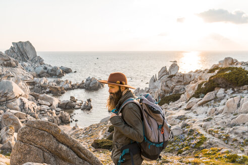Italy, Sardinia, hiker with hat and backpack - AFVF00409