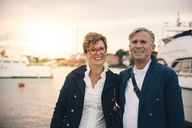 Portrait of confident senior couple smiling at harbor - MASF01436