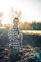 Portrait of confident male farmer with shovel standing on organic farm - MASF01535