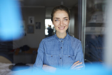 Portrait of smiling woman wearing denim shirt - PNEF00581