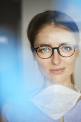 Portrait of woman with surgical mask wearing glasses - PNEF00596