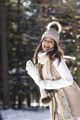 Portrait of fashionable young woman  in winter forest - ABIF00290