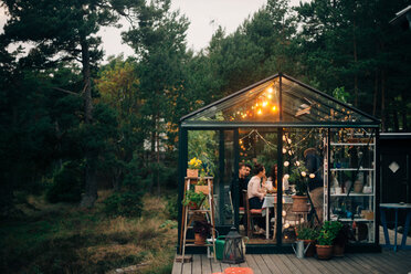 Friends having party in glass cabin during sunset - MASF01905