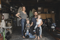 Portrait of parents and children in storage room of house - MASF02153