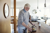 Senior man holding breakfast in tray at home - MASF02192