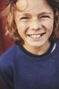 Portrait of cheerful teenage boy in back yard - MASF02197
