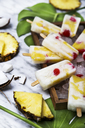 Pina Colada popsicles with candied cherries and pineapple - RTBF01162