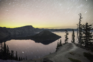 Scenic view of lake against star trails in sky during sunset - CAVF35554