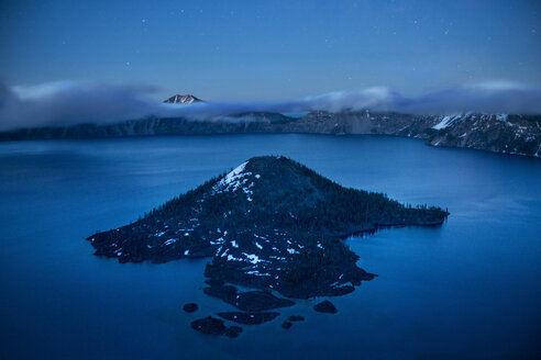 Scenic view of Wizard island in crater lake against sky at dusk - CAVF35605