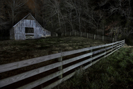 Old barn on field in forest at night - CAVF35608