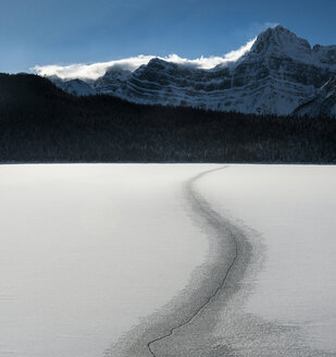 Crack on snowy land against snowcapped mountains at Icefields Parkway - CAVF35728