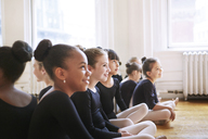 Happy ballerinas sitting at ballet studio - CAVF36118