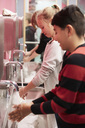 Junior high students washing hands in school - MASF02341