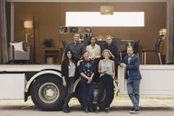 Full length portrait of confident multi-ethnic business team at portable office truck - MASF02440