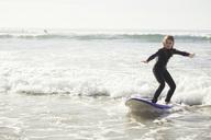 Full length of girl surfing in sea - MASF02503