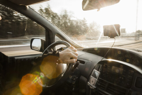 Cropped image of man driving car on sunny day - MASF02531