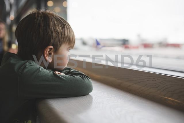 Boy looking through window of restaurant - MASF02651
